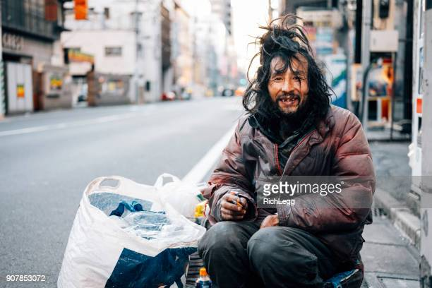 homeless man in tokyo japan - homeless foto e immagini stock