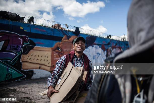 A homeless man is seen with cardboards in Bogota Colombia on December 15 2017 Homeless people eat their meal distributed by volunteers in Bogota...