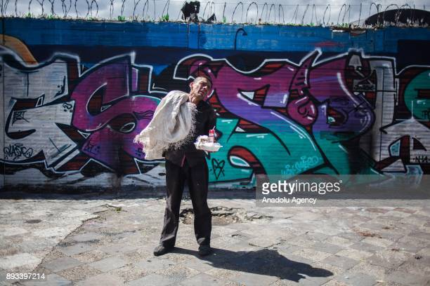 A homeless man is seen with his foods distributed by volunteers in Bogota Colombia on December 15 2017 Homeless people eat their meal distributed by...
