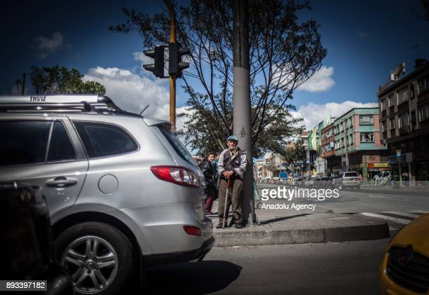A homeless man is seen with his walking stick in Bogota Colombia on December 15 2017 Homeless people who are called 'CHC' Ciudadanos Habitantes de la...