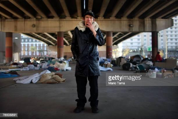 Homeless man Jack Halterman stands beneath Interstate 10 where over 100 homeless people sleep each night December 16 2007 in New Orleans Louisiana...