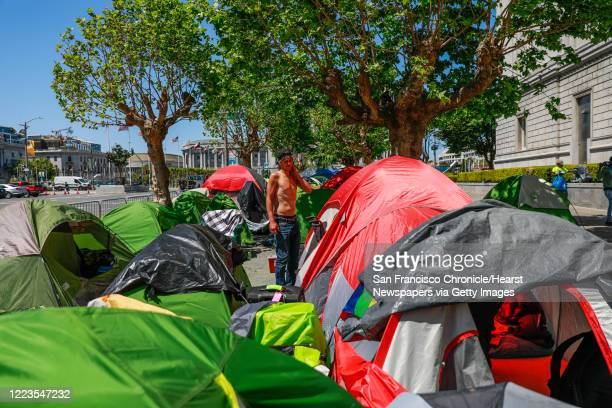 Homeless man Jacob Corbin stands in a tent encampment on Fulton Street on Wednesday, May 6, 2020 in San Francisco, California. San Francisco city...