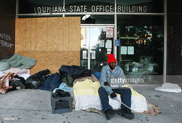 Homeless man Jay Ross sits on his bed in Duncan Plaza across from City Hall where over 100 homeless people sleep each night December 16 2007 in New...