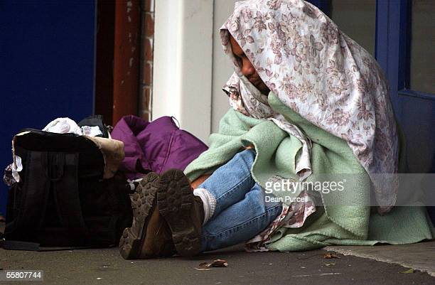 A homeless man keeps warm in the doorway of a central city shop in Auckland Tuesaday