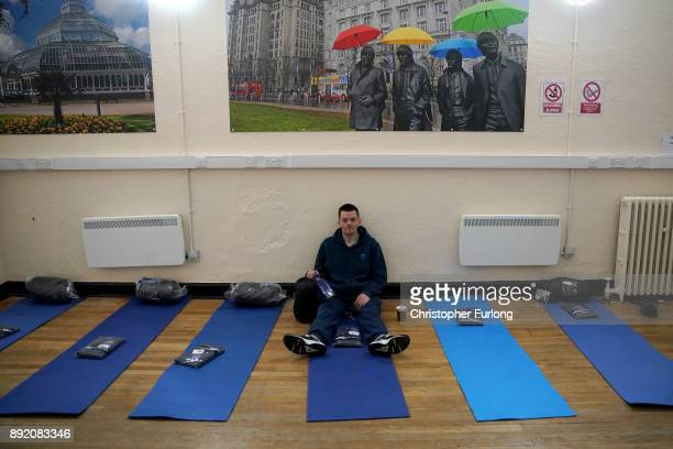 Homeless man Lee sits on a sleeping mat the new Labre House rough sleepers shelter on December 12 2017 in Liverpool England Labre House named after...