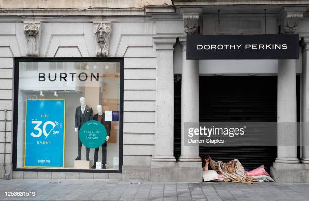 Homeless man lies in the doorway of a closed Dorothy Perkins clothes store during lockdown on July 01, 2020 in Leicester, England. Ten per cent of...