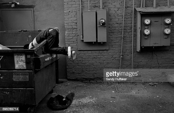 A homeless man looks for items in a dumpster in downtown Calexico California on January 16 2011 The Imperial Valley A hot dry and desolate regioon...