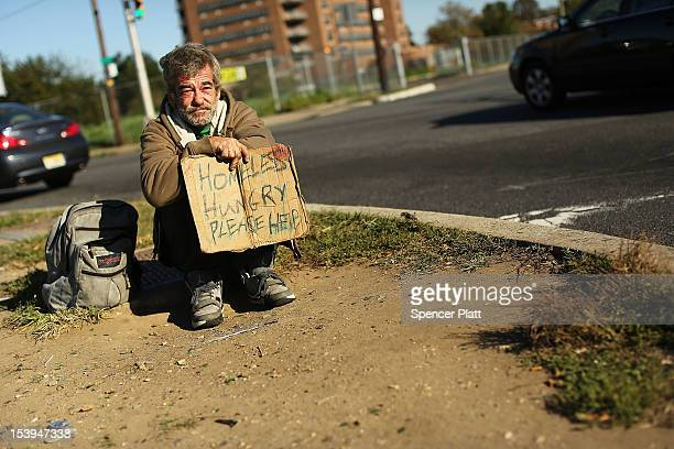 Homeless man named Bob waits for donations from passing motorists on October 11, 2012 in Camden, New Jersey. According to the U.S. Census Bureau,...