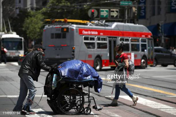 A homeless man pushes a cart with his belongings on May 17 2019 in San Francisco California Results of a twoyear Homelessness PointinTime Count show...