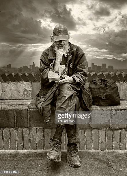 Homeless Man Reading Book