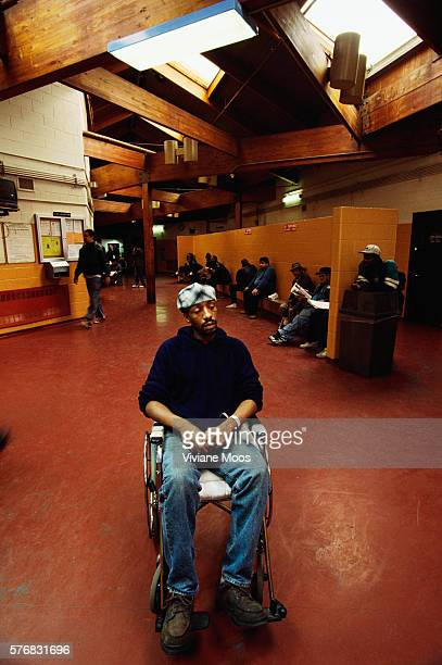 A homeless man sits in a wheelchair at the Charles H Gay Shelter Care Center on Ward's Island in New York City The center provides health care...