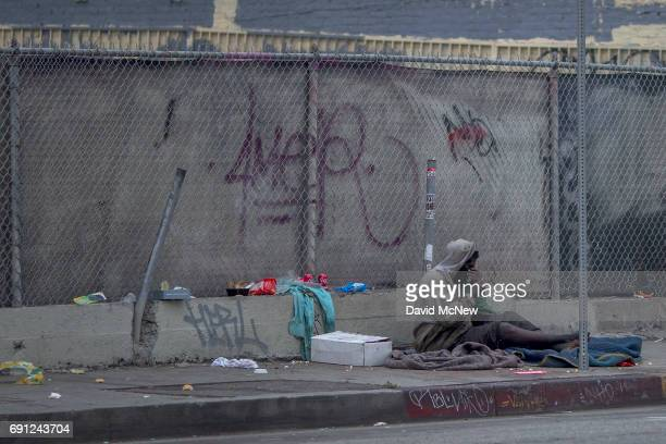 A homeless man sits on a downtown sidewalk where he had slept on May 1 2017 in Los Angeles California The newly released 2017 Greater Los Angeles...