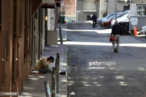 A homeless man sits on the sidewalk on May 17 2019 in San Francisco California Results of a twoyear Homelessness PointinTime Count show a 17 percent...