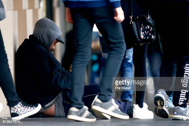 A homeless man sits on the street in the Auckland CBD on July 13 2017 in Auckland New Zealand Research by Roy Morgan found that economic issues were...