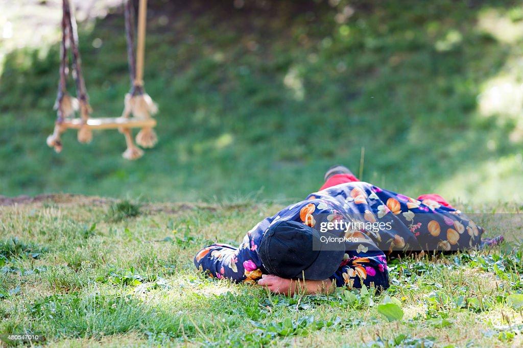 Homeless man sleeping dogs : Stock Photo