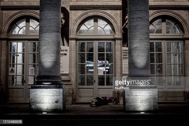 Homeless man sleeping in front of Le Grand Theatre in Bordeaux, France, on April 20, 2020 during the Coronavirus emergency