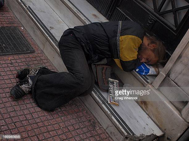 Homeless man sleeping in the streets in the centre of Athens, Greece.