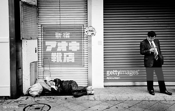 Homeless man sleeping in the streets of Tokyo