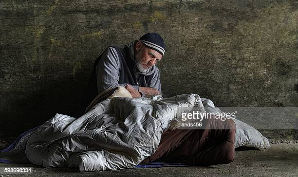homeless man sleeping rough - homeless stock photos and pictures