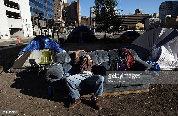 A homeless man sleeps beneath Interstate 10 where hundreds of homeless people sleep each night February 10 2008 in New Orleans Louisiana Affordable...