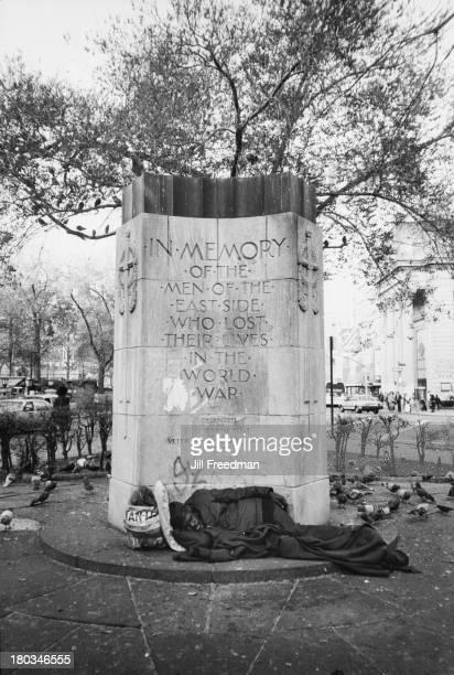 A homeless man sleeps by the Stuyvesant Post War Memorial New York City circa 1982