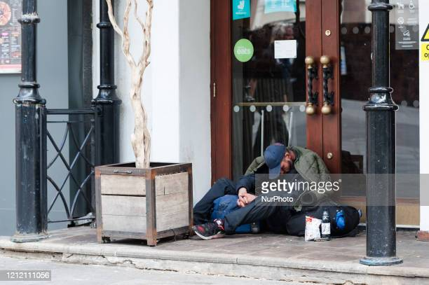 Homeless man sleeps in a doorway of a restaurant in Leicester Square in central London as the UK's nationwide lockdown to slow down the spread of the...