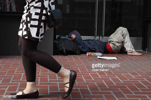 A homeless man sleeps in the doorway of a closed store on September 16 2010 in San Francisco California The US poverty rate increased to a 143...