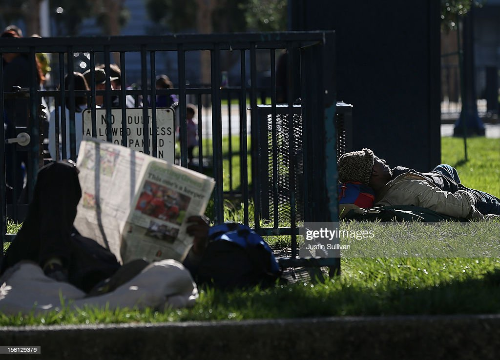 A homeless man sleeps in the park on December 10, 2012 in San Francisco, California. Despite efforts from the Federal Government and local officials to provide more shelters and beds for homeless people, the number of people living on the streets remained unchanged from January 2011 to January 2012. The number of homeless families increased while the number of veterans on the street decreased.