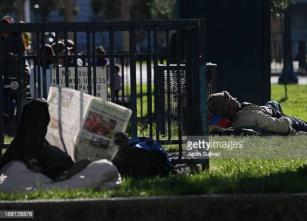 A homeless man sleeps in the park on December 10 2012 in San Francisco California Despite efforts from the Federal Government and local officials to...