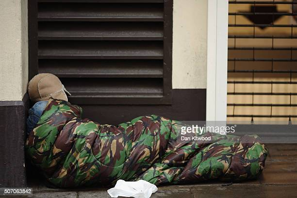 A homeless man sleeps near Trafalgar Square on January 27 2016 in London England A group of 21 charities including Crisis St Mungos and Centrepoint...