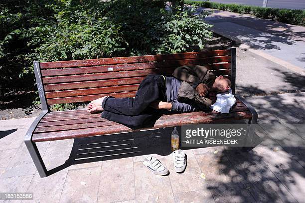 A homeless man sleeps on a bench in Budapest downtown in a file photo of June 18 2013 Homeless Hungarians are hit by ban a new Hungarian law...