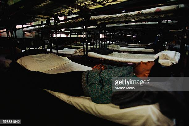 Homeless man sleeps on a bunk at the McCauley Water Street Mission in New York City.