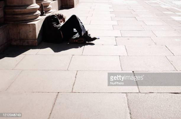 Homeless man sleeps on a near-deserted Piccadilly in London, England, on May 6, 2020. Britain is now well into its seventh week of coronavirus...