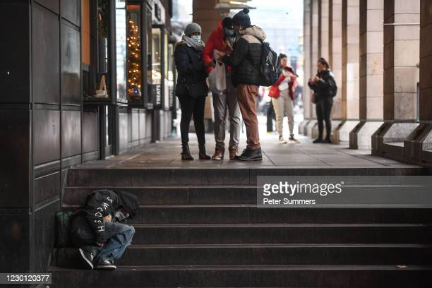 Homeless man sleeps on a set of stairs on December 13, 2020 in London, England. The number of new rough sleepers has risen in London this year amid...
