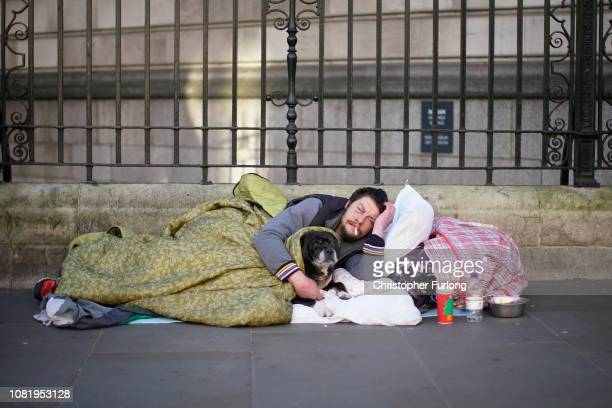 A homeless man sleeps on the street in central London after one of the coldest nights so far this winter on December 13 2018 in London United Kingdom...