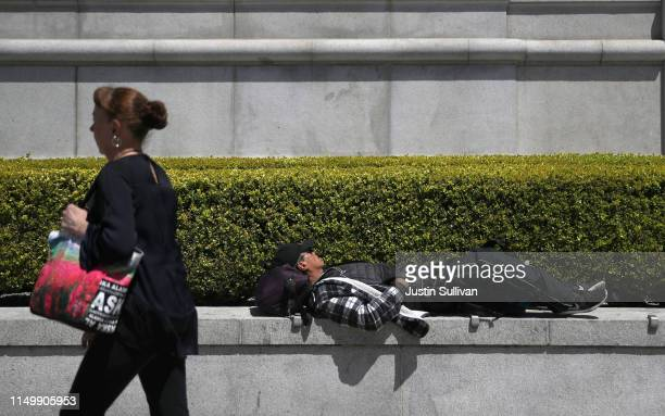 A homeless man sleeps outside of the Asian Art Museum on May 17 2019 in San Francisco California Results of a twoyear Homelessness PointinTime Count...