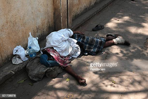 Homeless man thrown on the streets of Bangalore, India
