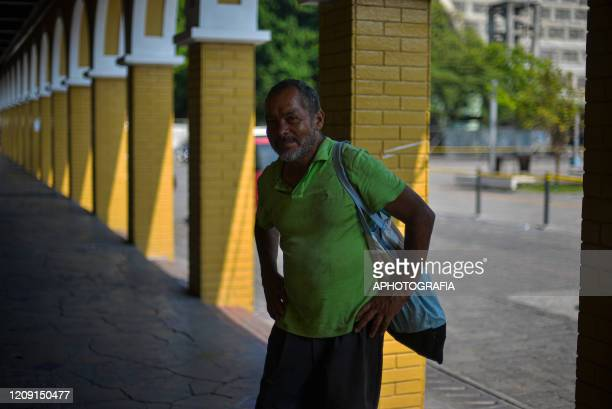 A homeless man walks through an empty plaza as people opt to comply with the government issued curfew on April 2 2020 in San Salvador El Salvador On...