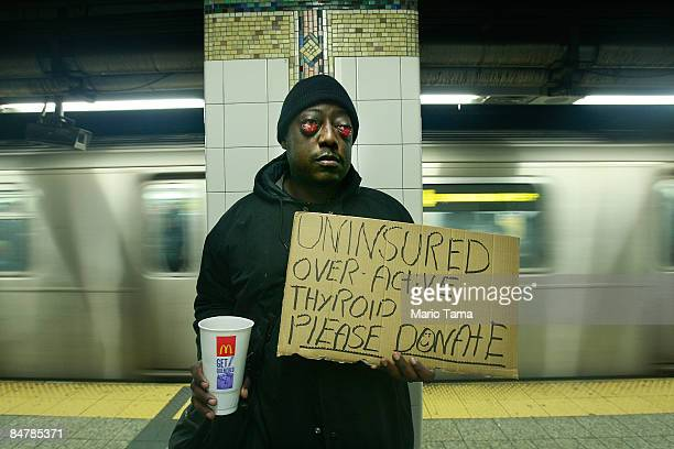 Homeless man Wendell Scott who says an overactive thyroid that causes the muscles behind his eye to swell collects change on a subway platform...