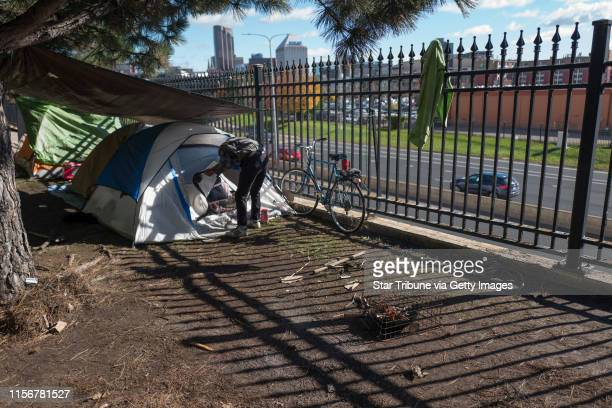 A homeless man who did not want his named used made coffee near his tent at the homeless encampment beneath the cathedral's hill Monday October 15...
