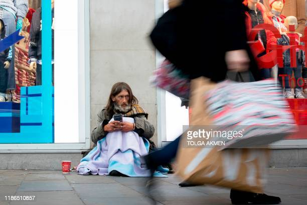 A homeless man who has been rough sleeping for 5 years begs in central London on November 8 2019 As record numbers of Britons flock to food banks and...