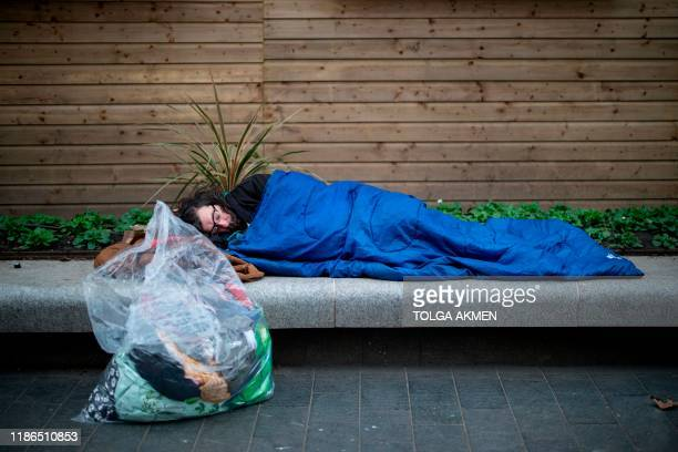 A homeless man who has been rough sleeping for 8 weeks sleeps in central London on November 8 2019 As record numbers of Britons flock to food banks...
