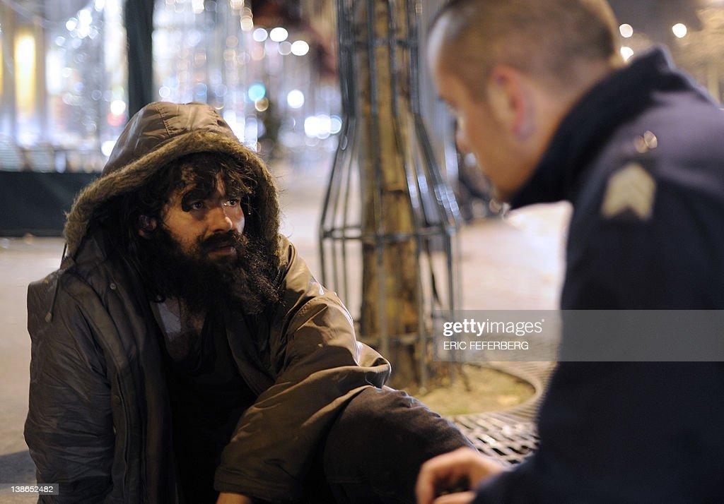 A homeless man who lies on the pavement : News Photo