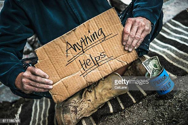 homeless man with money tin begging for money - homeless foto e immagini stock