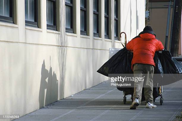 Homeless man with shopping cart