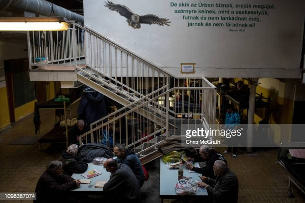 Homeless men are seen at the Oltalom Karitativ Egyesulet on January 19, 2019 in Budapest, Hungary. In June 2018 a law was approved that banned...