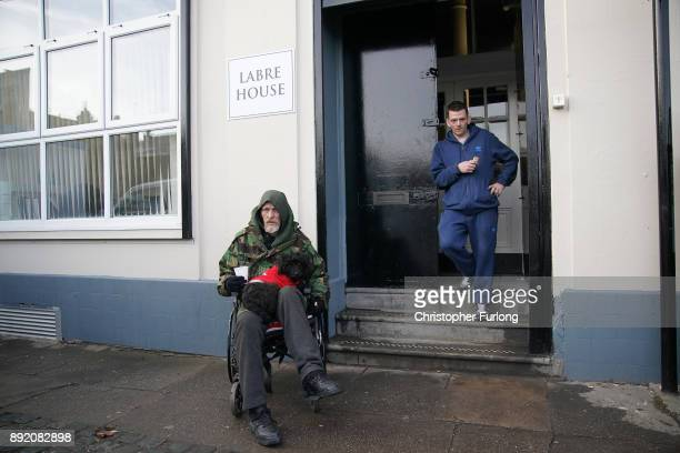 Homeless men Jason and Lee wait outside the new Labre House rough sleepers shelter on December 12 2017 in Liverpool England Labre House named after...