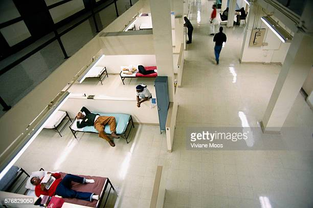 Homeless men rest on cots and socialize at the McAuley Mission homeless shelter The mission was founded by Jerry McAuley in 1872