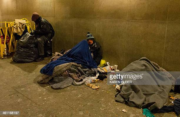 Homeless men try to get sleep at a Metro station entrance as temperatures dipped into the single digits Fahrenheit and minus degrees with the wind...
