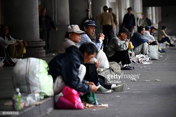 Homeless men wait around for the offer of work in the slum area of Kamagasaki on April 24 2016 in Osaka Japan Kamagasaki a district in Japan's second...